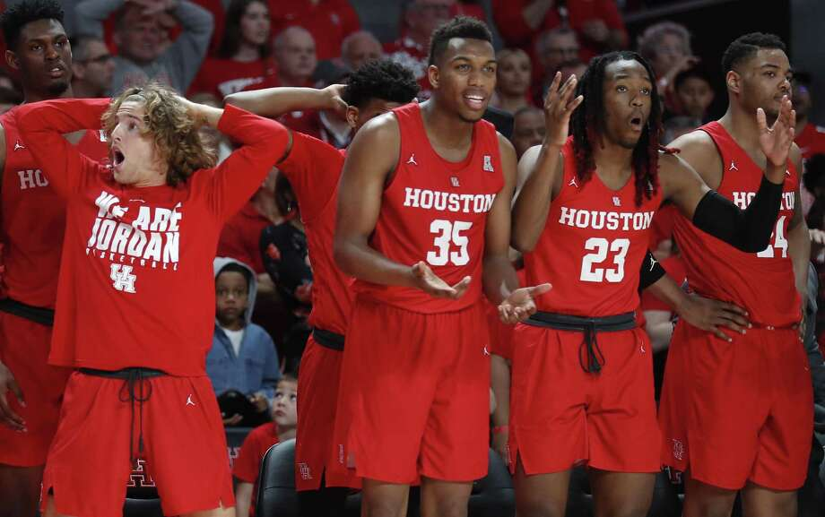 Houston guard Landon Goesling, left, forward Fabian White Jr. (35) forward Cedrick Alley Jr. (23) and forward Breaon Brady (24) react to a call during the second half on an NCAA basketball game against Central Florida at Fertitta Center on Saturday, March 2, 2019, in Houston. Photo: Brett Coomer, Houston Chronicle / Staff Photographer / © 2019 Houston Chronicle