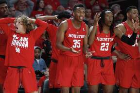 Houston guard Landon Goesling, left, forward Fabian White Jr. (35) forward Cedrick Alley Jr. (23) and forward Breaon Brady (24) react to a call during the second half on an NCAA basketball game against Central Florida at Fertitta Center on Saturday, March 2, 2019, in Houston.