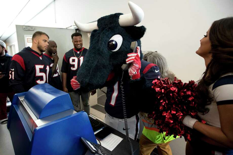 Just in time for football season, United Airlines is giving young adults a 10 percent discount on travel booked by Dec. 31. Pictures is Houston Texans mascot Toro, center, stands at the gate podium as linebacker Dylan Cole (51), cornerback Johnathan Joseph (24), and defensive end Carlos Watkins (91) help check passengers in to a flight bound for Chicago as the Texans players, cheerleaders and Toro visited with passengers and helped with some operations at George Bush Intercontinental Airport on Thursday, March 21, 2019, in Houston. Photo: Brett Coomer, Staff Photographer / © 2019 Houston Chronicle