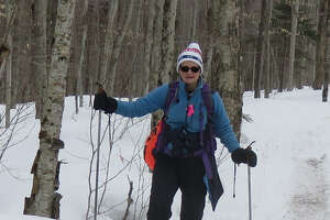 Outdoors writer Gillian Scott on the slightly muddy trail to Dry and Dexter lakes. (Herb Terns / Times Union)