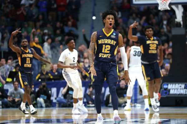 Murray State's Ja Morant celebrates after scoring at the end of the first half during the Racers' 83-64 first-round win over Marquette in the NCAA tournament at the XL Center in Hartford on Thursday. Morant finished with a triple double, recording 17 points, 11 rebounds and 16 assists.