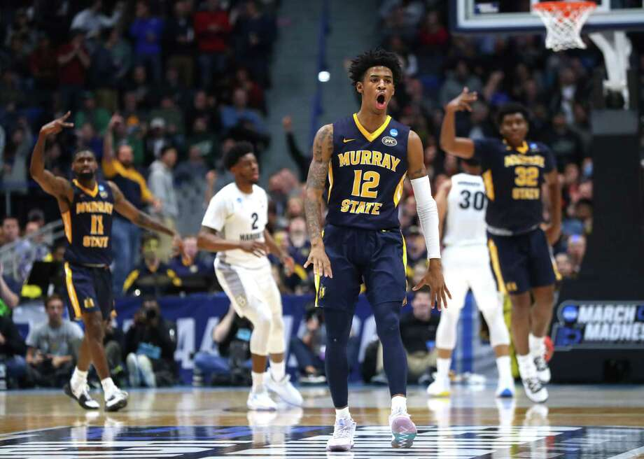Murray State's Ja Morant celebrates after scoring at the end of the first half during the Racers' 83-64 first-round win over Marquette in the NCAA tournament at the XL Center in Hartford on Thursday. Morant finished with a triple double, recording 17 points, 11 rebounds and 16 assists. Photo: Maddie Meyer / Getty Images / 2019 Getty Images