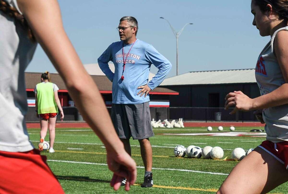 Lumberton's head coach of girl's soccer Jason Hopson watches as he players work during Lumberton's practice. Photo taken on Thursday, 03/21/19. Ryan Welch/The Enterprise