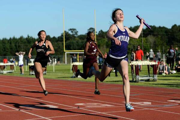 PN-G's Jacie Droddy wins in the 4x100 meter relay during Silsbee's Tiger Relay at Tiger Stadium Thursday in Silsbee. Photo taken on Thursday, 03/21/19. Ryan Welch/The Enterprise