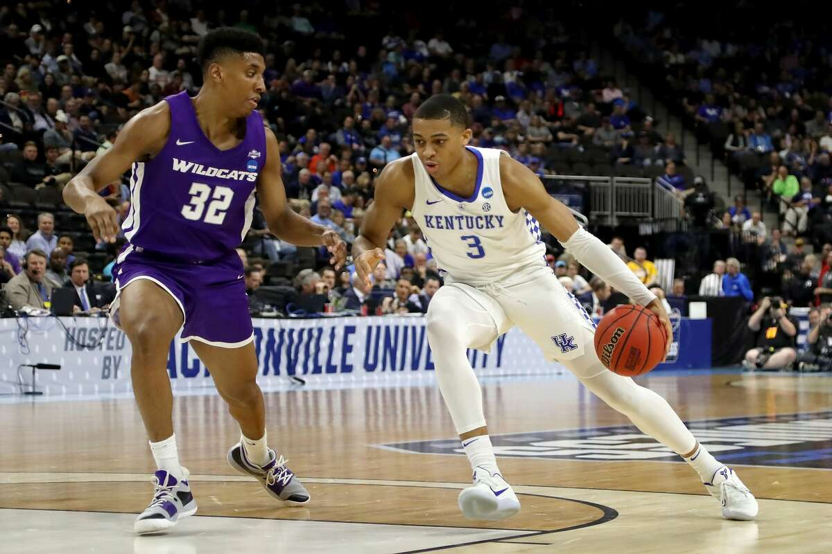 JACKSONVILLE, FLORIDA - MARCH 21: Keldon Johnson #3 of the Kentucky Wildcats dribbles the ball while being guarded by Joe Pleasant #32 of the Abilene Christian Wildcats in the first half during the first round of the 2019 NCAA Men's Basketball Tournament at Jacksonville Veterans Memorial Arena on March 21, 2019 in Jacksonville, Florida. (Photo by Sam Greenwood/Getty Images)