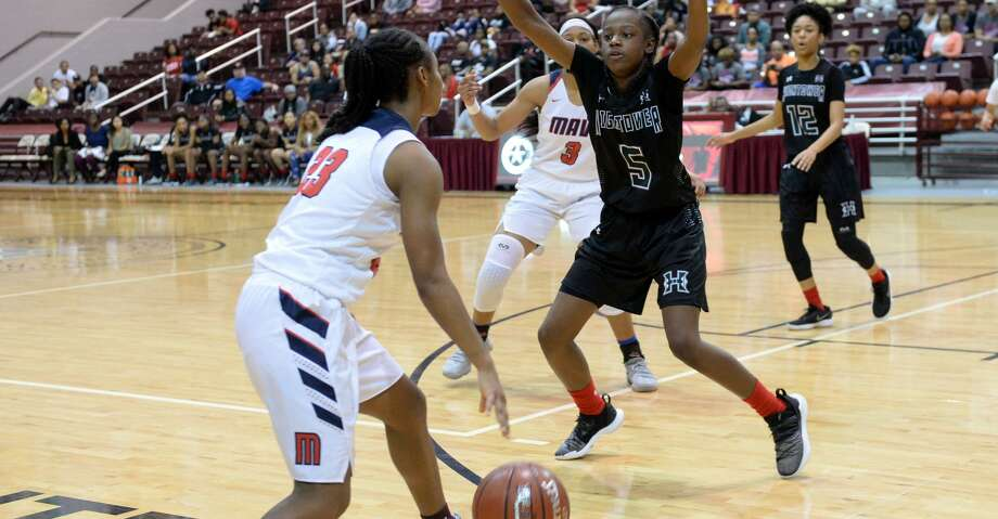 Tae'lor Purvis (5) of Hightower guards McKinzie Green (23) of Manvel during the second half of a Class 5A, Region III final basketball playoff game between the Hightower Hurricanes and the Manvel Mavericks on Saturday, February 23, 2019 at the Campbell Center, Houston, TX. Photo: Craig Moseley/Staff Photographer