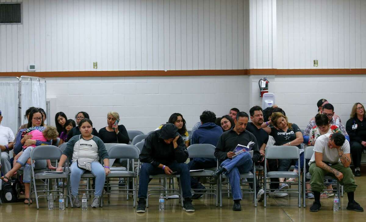 People wait to be seen by a physician at Harris County Public Health's mobile clinic Thursday, March 21, 2019, in Deer Park, Texas. The clinic was setup in response to the aftermath of the ITC petrochemical fire.