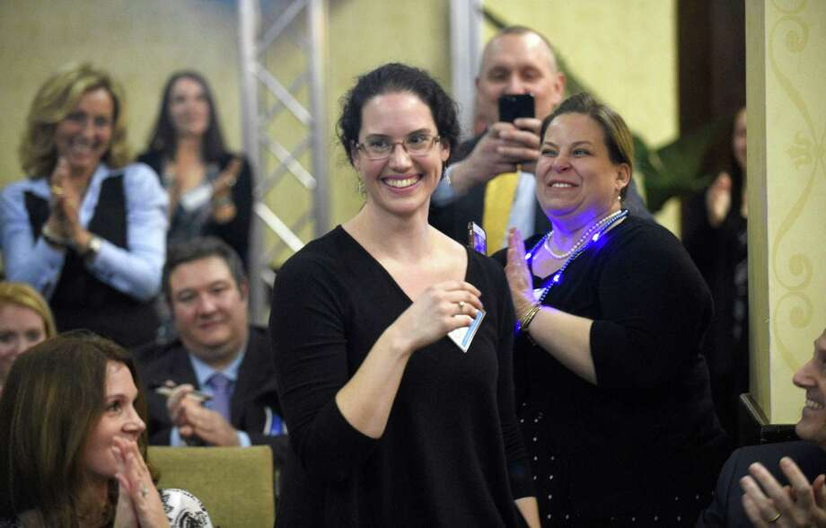Janell Iver, a Stamford High School teacher, reacts after being honored with the 2019 Educator of the Year award by Stamford Public Education Foundationduring a ceremony at the Stamford Sheraton Hotel on March 21 in Stamford. Katelyn Tavolacci, a Julia A. Stark Elementary School fifth-grade teacher, was also recognized during the ceremony as the Stamford Public Schools Teacher of the Year. Photo: Matthew Brown / Hearst Connecticut Media / Stamford Advocate