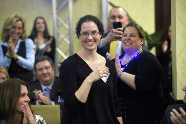 Janell Iver, a Stamford High School teacher, reacts after being honored with the 2019 Educator of the Year award by Stamford Public Education Foundation (SPEF) during a ceremony at the Stamford Sheraton Hotel on March 21, 2019 in Stamford, Connecticut. Katelyn Tavolacci, a Julia A. Stark Elementary School fifth-grade teacher was also recognized during the ceremony as the Stamford Public Schools Teacher of the Year.