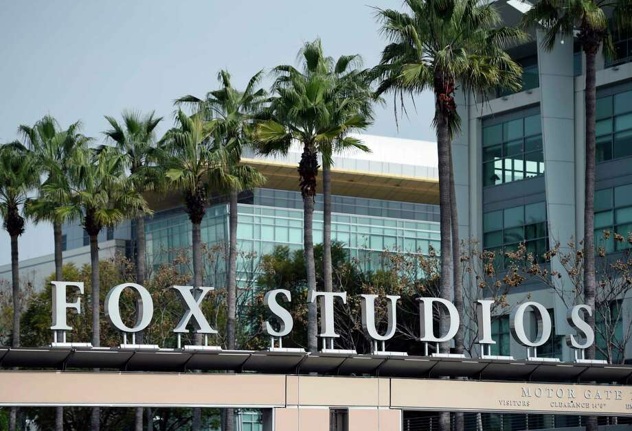 The Fox Studios sign is pictured at the entrance to the lot, Tuesday, March 19, 2019, in Los Angeles. Disney's $71.3 billion acquisition of Fox's entertainment assets is set to close around 12 a.m. EDT on Wednesday. (AP Photo/Chris Pizzello) Photo: Chris Pizzello / Invision