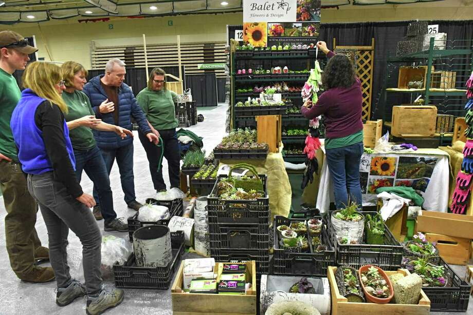Vendors from Balet Flowers and Design set up their booth for the 32nd annual Capital District Garden and Flower Show Hudson Valley Community College on Thursday, March 21, 2019 in Troy, N.Y. (Lori Van Buren/Times Union) Photo: Lori Van Buren / 40046474A
