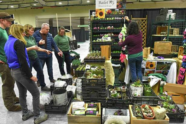 Vendors from Balet Flowers and Design set up their booth for the 32nd annual Capital District Garden and Flower Show Hudson Valley Community College on Thursday, March 21, 2019 in Troy, N.Y. (Lori Van Buren/Times Union)