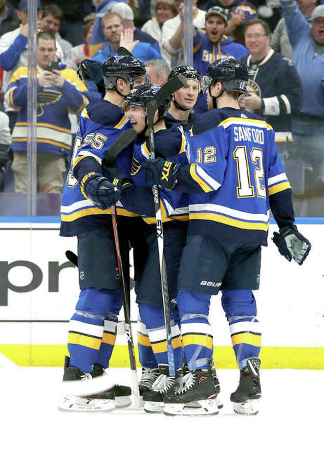 The Blues' Ivan Barbashev, center, celebrates with teammates Colton Parayko (55), Zach Sanford (12) and Jay Bouwmeester (19) after scoring a Thursday night against the Detroit Red Wings in St. Louis. Photo: AP Photo
