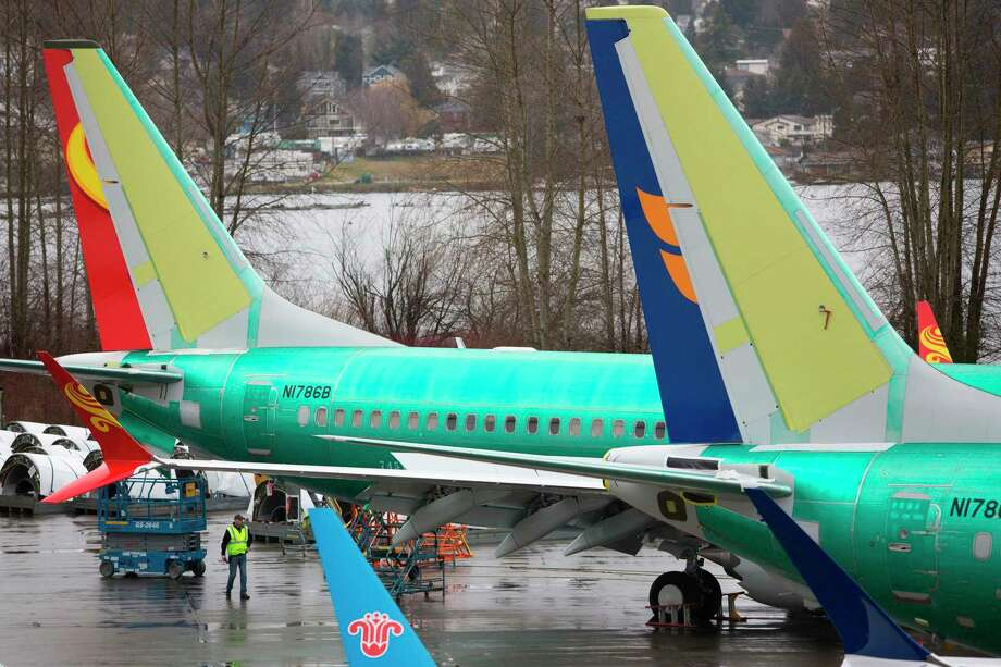 (FILES) In this file photo taken on March 12, 2019 Boeing 737 MAX airplanes are pictured at the Boeing Renton Factory in Renton, Washington. - Boeing's 737 MAX aircraft will be outfitted with a warning light for malfunctions in its MCAS anti-stall system, suspected in October's fatal crash in Indonesia, an industry source told AFP. This safety light, which had been optional, will become standard and is among the modifications the company will present to US authorities and clients in the coming days, the source said on condition of anonymity. (Photo by Jason Redmond / AFP)JASON REDMOND/AFP/Getty Images Photo: JASON REDMOND / AFP or licensors