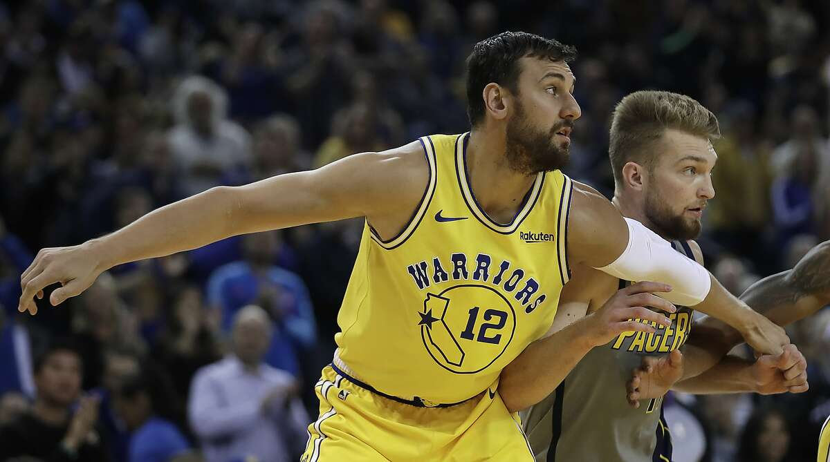 Golden State Warriors' Andrew Bogut (12) blocks out Indiana Pacers' Domantas Sabonis, right, during the first half of an NBA basketball game Thursday, March 21, 2019, in Oakland, Calif. (AP Photo/Ben Margot)