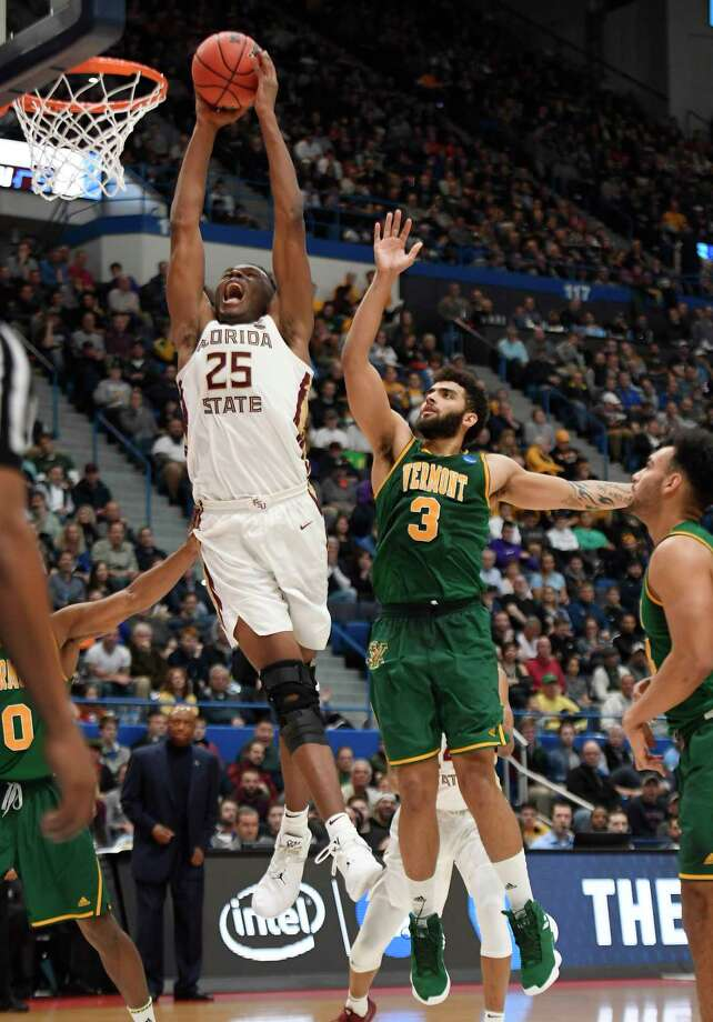 Florida State's Mfiondu Kabengele (25) dunks the ball over Vermont's Anthony Lamb (3) during the second half of a first round men's college basketball game in the NCAA tournament, Thursday, March 21, 2019, in Hartford, Conn. (AP Photo/Jessica Hill) Photo: Jessica Hill / Copyright 2019 The Associated Press. All rights reserved