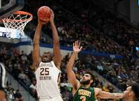 Florida State's Mfiondu Kabengele (25) dunks the ball over Vermont's Anthony Lamb (3) during the second half of a first round men's college basketball game in the NCAA tournament, Thursday, March 21, 2019, in Hartford, Conn. (AP Photo/Jessica Hill)
