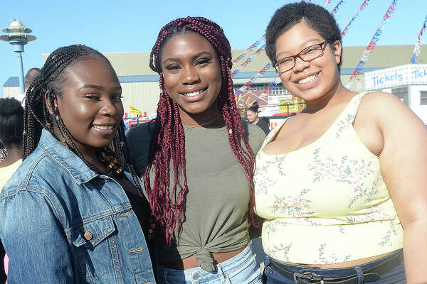 Iyiola Akinsanya, Christine Uchendu and Ashleigh Thomas were at the opening night of the YMBL South Texas State Fair at Ford Park. Photo taken Thursday, March 21, 2019 Kim Brent/The Enterprise
