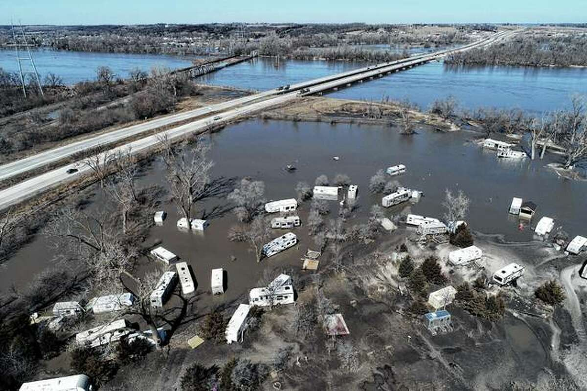 An aerial photo shows flooding Wednesday near the Platte River in Plattsmouth, Nebraska, south of Omaha. The National Weather Service is warning that flooding in parts of South Dakota and northern Iowa soon could reach historic levels. The National Oceanic and Atmospheric Administration said Thursday that it is expecting unprecedented major flooding this spring.