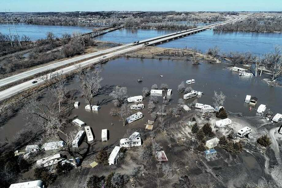 An aerial photo shows flooding Wednesday near the Platte River in Plattsmouth, Nebraska, south of Omaha. The National Weather Service is warning that flooding in parts of South Dakota and northern Iowa soon could reach historic levels. The National Oceanic and Atmospheric Administration said Thursday that it is expecting unprecedented major flooding this spring. Photo: DroneBase Via AP