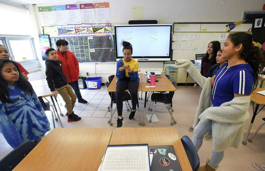 "Student's in Alisha Barry's AVID class at Western Middle School participate in a team building classroom exercise ""Would you Rather"" on March 8, 2019, at the school in Greenwich, Connecticut. Photo: Matthew Brown / Hearst Connecticut Media / Stamford Advocate"