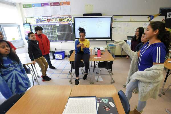 """Student's in Alisha Barry's AVID class at Western Middle School participate in a team building classroom exercise """"Would you Rather"""" on March 8, 2019, at the school in Greenwich, Connecticut."""