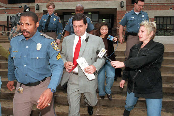 DAILY / METRO: Former City Councilman Bobby Herrera, flanked by media and Bexar County Sheriff s Deputies, leaves the jail Sunday morning after serving time for contempt of court. Staff Photo By: John Davenport, 98-1076.
