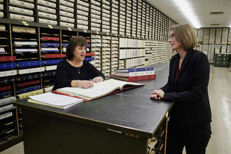 Angela Mulligan, left, a title searcher with SMPR Title Agency and Melissa Clement, SMPR chief operating officer, talk at the Saratoga County Clerk's office on Thursday, March 14, 2019, in Ballston Spa, N.Y.    (Paul Buckowski/Times Union) Photo: Paul Buckowski / (Paul Buckowski/Times Union)