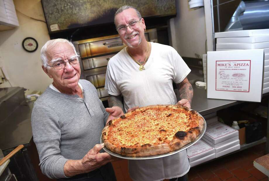 Frank Buonocore (left), owner of Mike's Apizza, and his son, Mike, are photographed at their pizza restaurant on Campbell Ave. in West Haven on March 20, 2019. Photo: Arnold Gold / Hearst Connecticut Media / New Haven Register