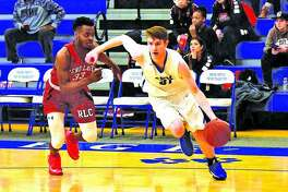 Oliver Stephen, right, of Southwestern Illinois, dribbles past a defender during a game last season. Stephen is a 2017 Edwardsville High School graduate and will be a sophomore at SWIC.