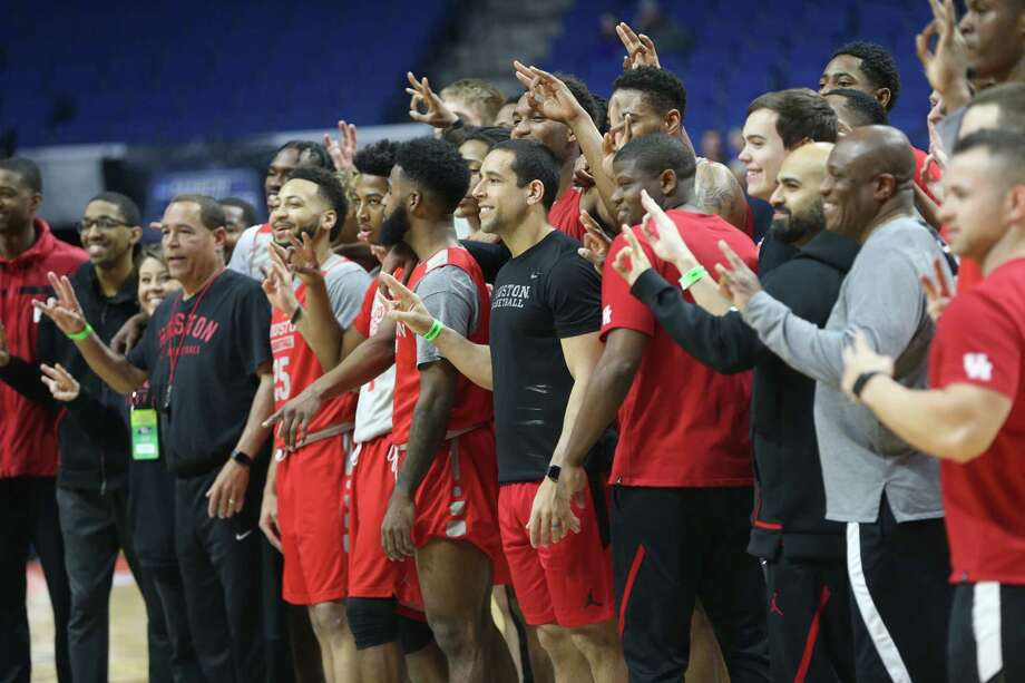 University of Houston's Men's basketball team poses for a photo  at BOK Center on Wednesday, March 21, 2018 in Tulsa. The Cougars are taking on Georgia State University Panthers in the first round of NCAA Men's Tournament. Photo: Elizabeth Conley, Staff Photographer / © 2018 Houston Chronicle