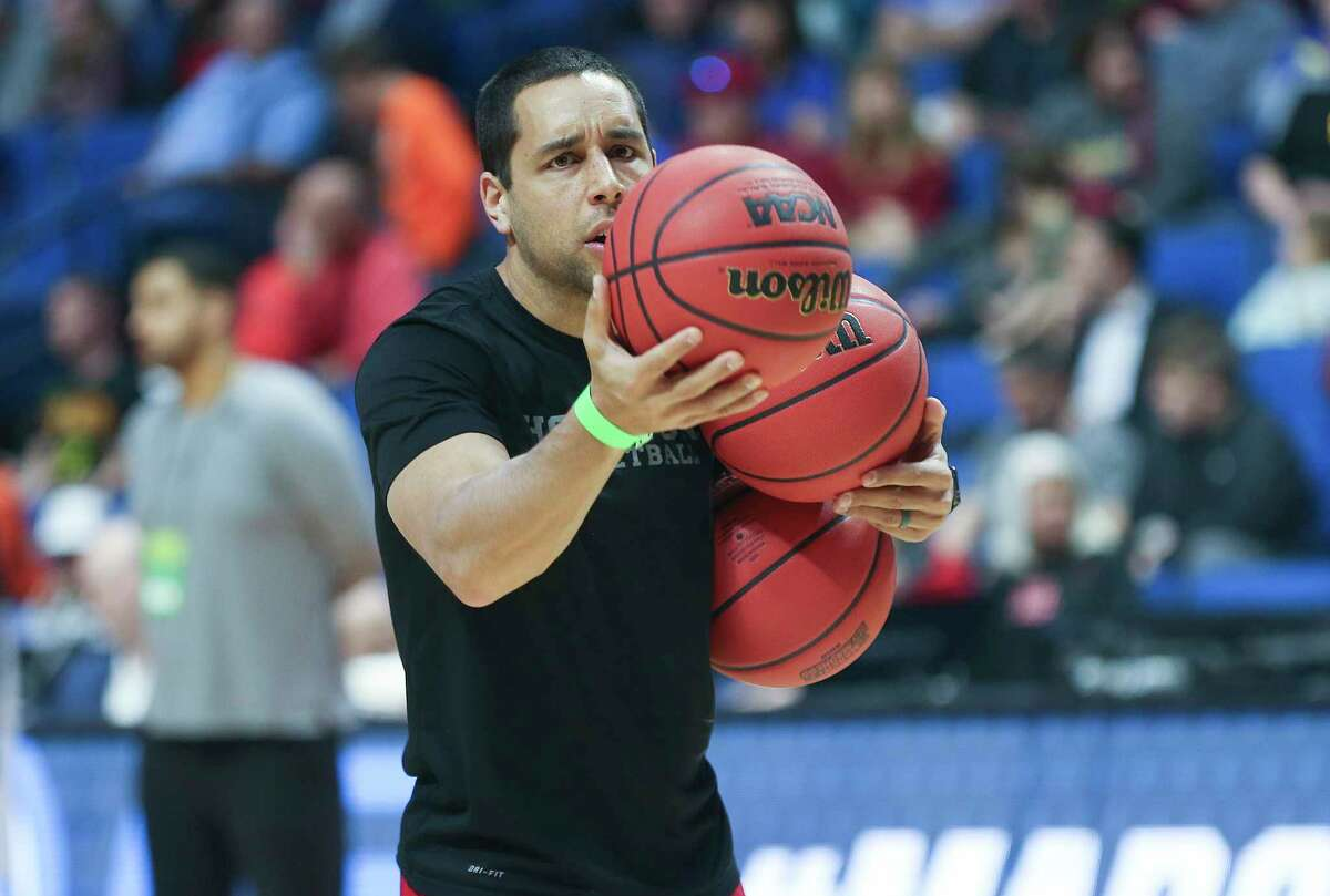 Houston Cougars assistant coach Kellen Sampson passes the ball to the players during drills at BOK Center on Wednesday, March 21, 2018 in Tulsa. The Cougars are taking on Georgia State University Panthers in the first round of NCAA Men's Tournament on Friday.