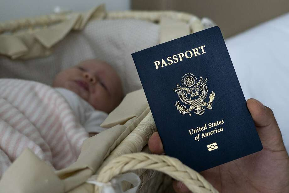 Denis Wolok holds the U.S. passport issued to his infant daughter, Eva, in Hollywood, Fla. Hundreds of Russians like his wife, Olga Zemlyanaya, travel to the United States to give birth. Photo: Iuliia Stashevska / Associated Press