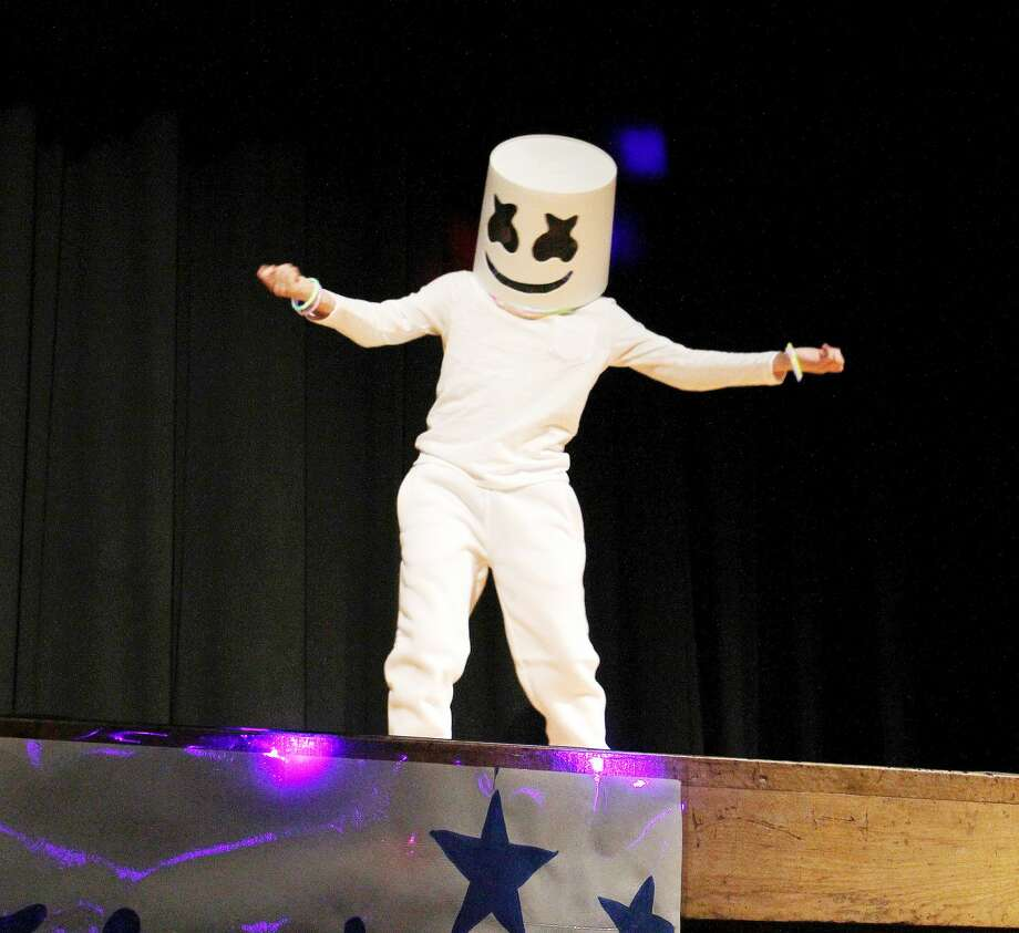 Gearing up for nationwide tour next month, Marshmello got the crowd hype Thursday night during the Bad Axe Talent Show. Marshmello, played by Bad Axe fourth grader Quentin Eisinger, performed his latest hit, Happier. The talent show featured 24 different acts ranging from musical performances to stand up comedy. Photo: Bradley Massman/Huron Daily Tribune