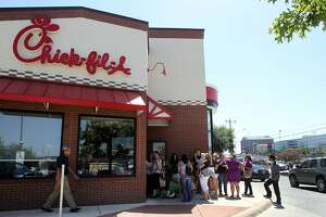 A crowd lines up outside of the Chick-fil-A restaurant on Loop 410 near McCullough during the lunch hour Wednesday August 1, 2012. Many of the customers were there to show their support for the restaurant's leadership that recently voiced its disapproval of same sex marriage. John Davenport/©San Antonio Express-News