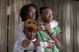"From left, Evan Alex, Lupita Nyong'o and Shahadi Wright Joseph in a scene from ""Us,"" written, produced and directed by Jordan Peele."