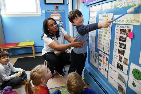 Preschool lead teacher Jacqueline Valle teaches her class at Honey Bear Learning Center in Stratford earlier this month. Valle submitted testimony to the state Legislature ,which is considering a bill to raise pay rates for early childhood educators.