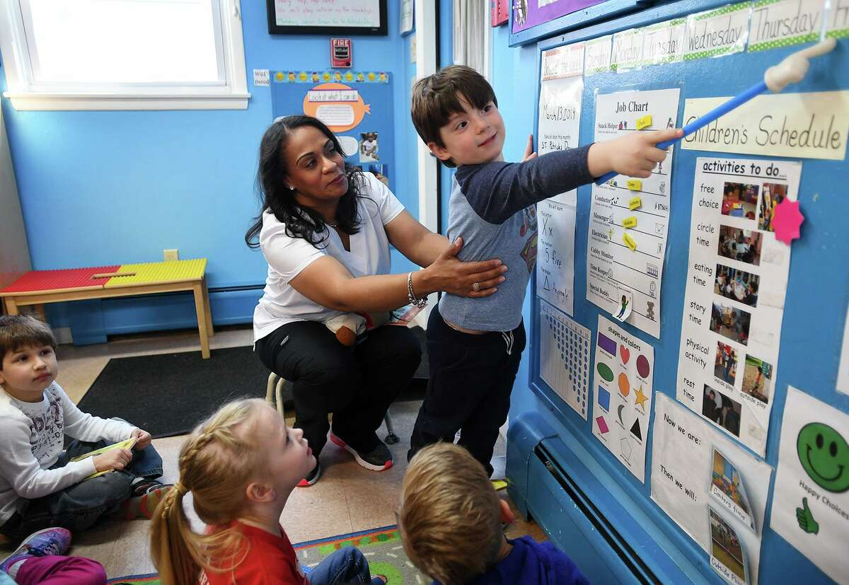 Preschool lead teacher Jacqueline Valle teaches her class at Honey Bear Learning Center in Stratford, Conn. on Wednesday, March 13, 2019. Valle submitted testimony to the state legislature which is considering a bill to raise pay rates for early childhood educators.