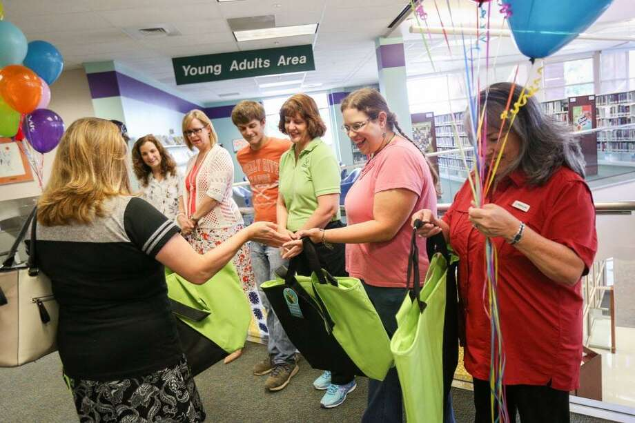Amy Ressler, Texas A&M AgriLife County Extension Agent, hands out tote bags to the Central Library team of the Walk Across Texas program on Tuesday, June 20, 2017, at the Montgomery County Central Library. Photo: Michael Minasi, Staff Photographer / Houston Chronicle / Internal