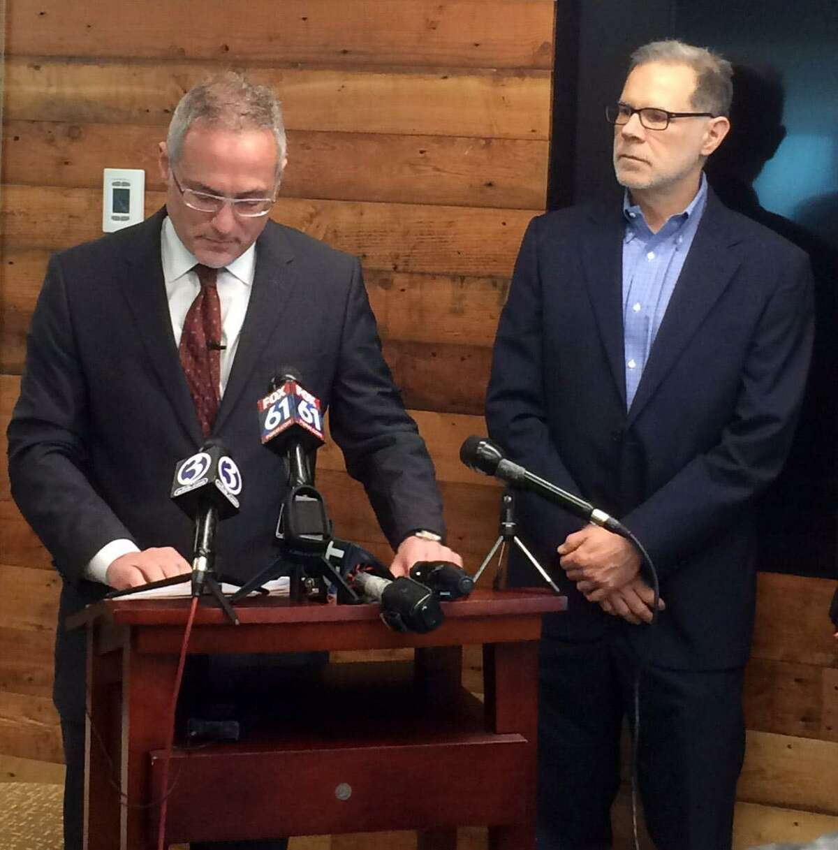 Attorney Antonio Ponvert III (left) and Albert Shehadi address the news media during a press conference in Bridgeport on Thursday, March 1, 2018, after filing federal and state lawsuits claiming abuse by employees of the state's psychiatric hospital. A Bridgeport judge has refused to dismiss the case against the state.