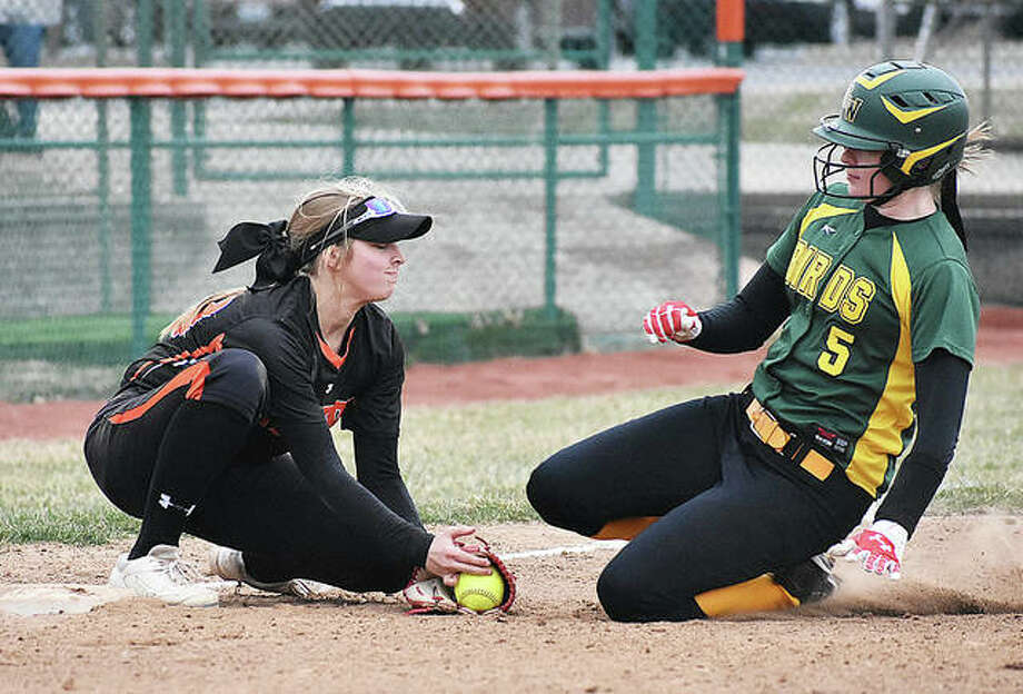 Southwestern's Bailee Nixon (right) slides in with a triple as Edwardsville third baseman Lexi Gorniak takes the throw during a Piasa Birds win Wednesday in Edwardsville. The Birds were home in Piasa on Thursday and pushed their record to 5-1 with a victory over Civic Memorial. Photo: Matt Kamp / Hearst Illinois