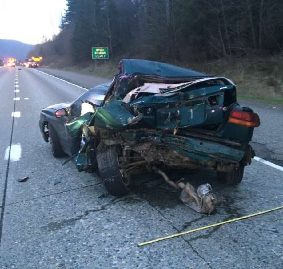 A man was killed and a woman was injured Friday morning after a bus slammed into a car stalled on westbound Interstate 90 near Snoqualmie. Photo: Courtesy WSP