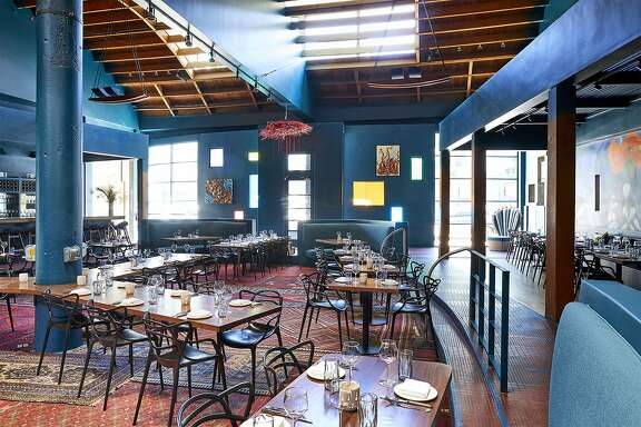 Cass Calder Smith and the team at CCS Architecture designed Palette's colorful dining room.