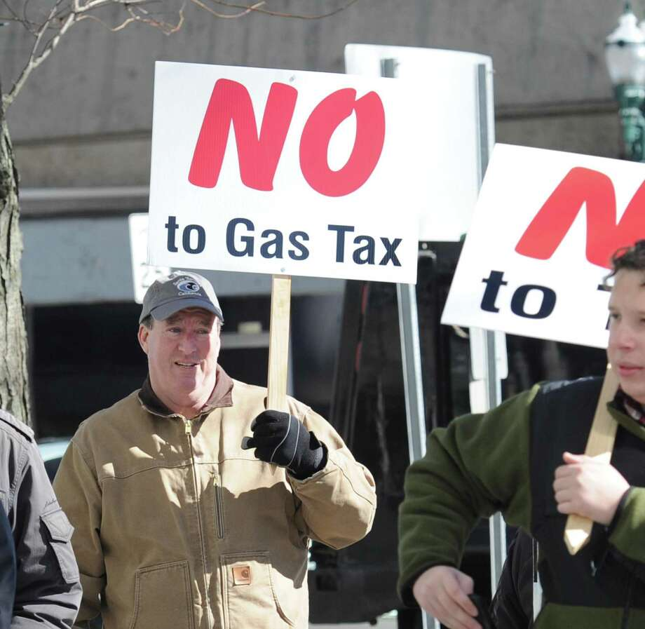 Public protests against tolls are held in front of the Stamford Goverment Center last year. Photo: Bob Luckey Jr. / Hearst Connecticut Media / Greenwich Time