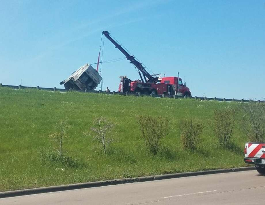 A wreck involving a garbage truck on U.S. 69 and Fourth Street has caused all northbound lanes to close. Photo: Guiseppe Barranco/The Enterprise