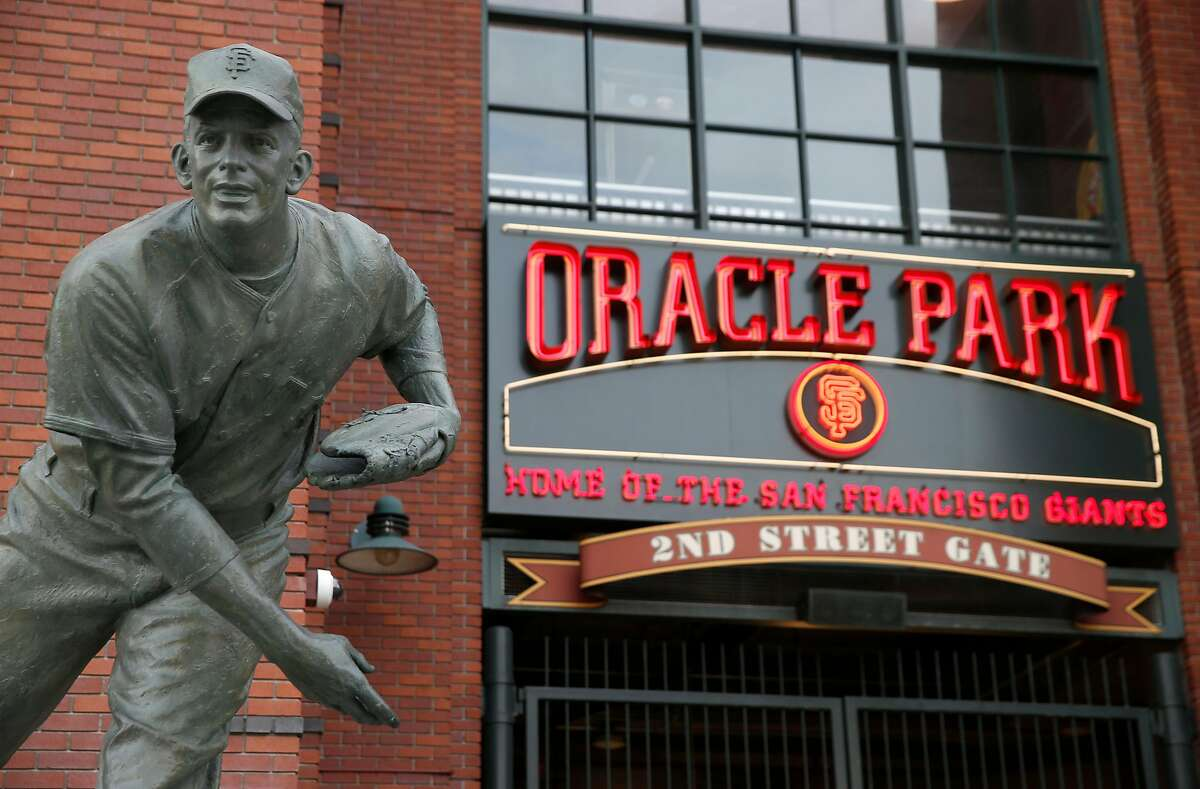 A sign behind the Gaylord Perry statue and above the 2nd Street entrance to Oracle Park is installed to reflect the name change of the Giants' home stadium in San Francisco, Calif. on Tuesday, March 19, 2019.