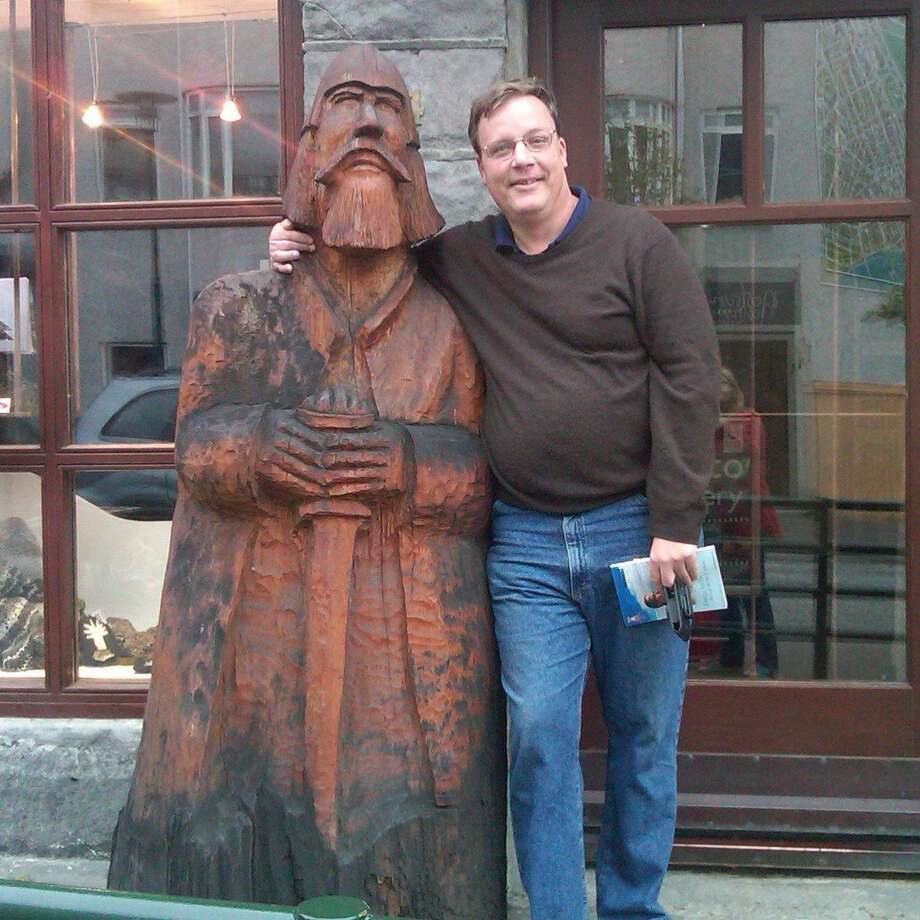 Steve Bennett insists his delivery is not as wooden as the Viking statue next to him in this recent photo taken in Iceland. Photo: Contributed Photo