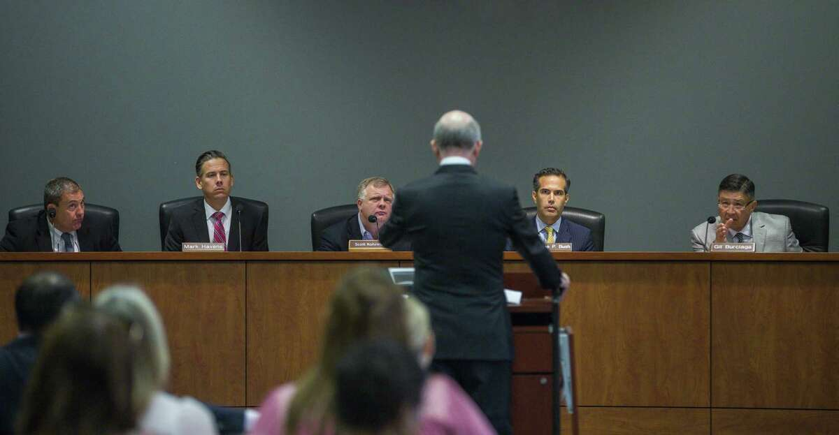 Texas' School Land Board controls how $10 billion of the state's $44 billion Permanent School Fund is invested. From right to left are board member Gilbert Burciaga, chairman George P. Bush, board member Scott Rohrman, and staffers Mark Havens, deputy land commissioner and Jeff Gordon, general counsel.