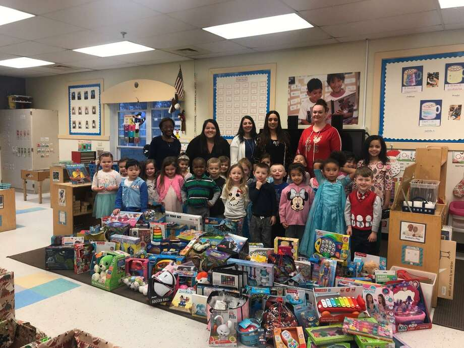 Milford KinderCare students collected several hundred toys for children in need during the holidays in December. Photo: Contributed Photo