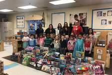 Milford KinderCare students collected several hundred toys for children in need during the holidays in December.
